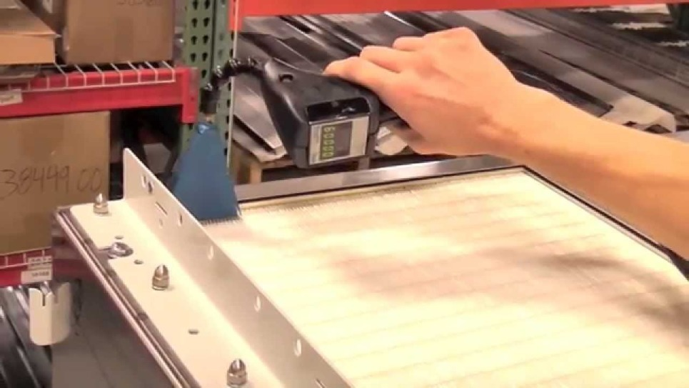 Video of HEPA filter leak testing using a particle counter and tracer aerosol