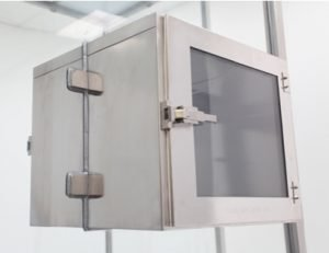 Stainless steel pass-through chamber installed in tempered glass wall panel.
